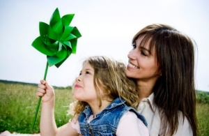 woman-and-girl-watch-green-toy-windmill
